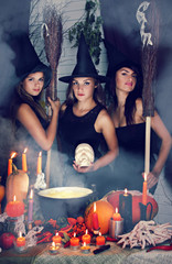 three witch with a skull.tinted