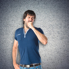 Man yawning over textured background