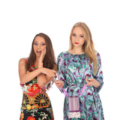 shopping and tourism concept - beautiful girls with bags