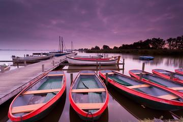 boats on lake harbor at sunrise