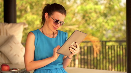 Young attractive woman surfing the web on tablet computer