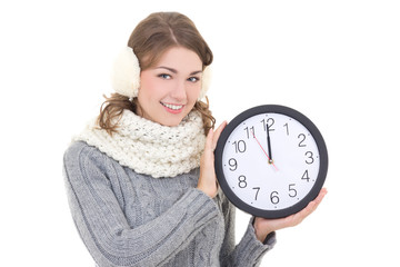 happy beautiful woman in winter clothes holding office clock iso