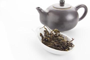 tea and teapot on white