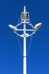 spotlights against blue sky