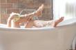 closeup leg women taking a shower in a bathtub - 70943398
