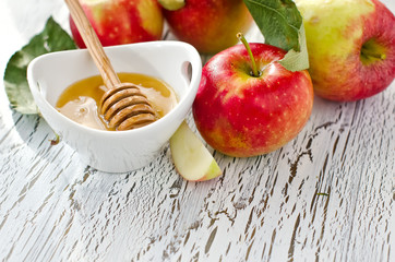 Fresh red apples with honey copy space
