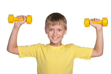 Smiling boy with dumbbells do exercises