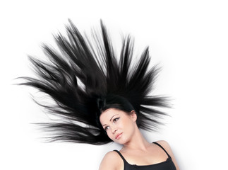 Woman with magnificent scattered hair on white background