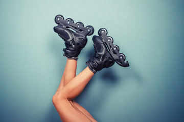 Legs of woman wearing rollerblades