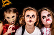 brother and two sisters on  Halloween party - 70946130
