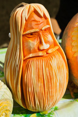 Carved pumpkin face of man with beard