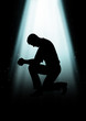 Silhouette illustration of a man praying under the light