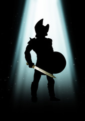 Silhouette of a gladiator standing under the light