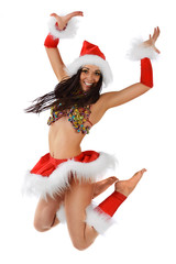 Cute sexy girl in christmas costume jumping isolated on white ba