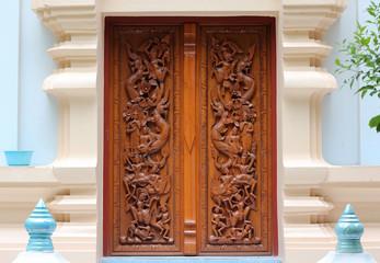 Thai wooden craft panel in Northern Thai temple.