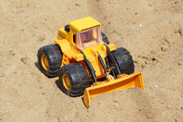 Toy yellow tractor