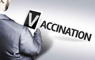 Business man with the text Vaccination in a concept image