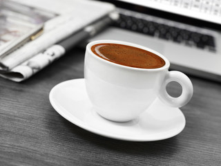 Coffee, newspapers and laptop