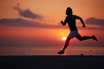 Athletic build jogger running with high speed, silhouette