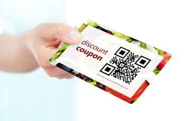 hand holding food discount coupon with qr code isolated over whi