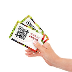 hand holding two discount coupons with qr code isolated over wh