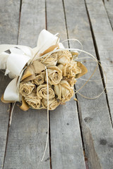 Bouquet of dried yellow roses on gray wooden background