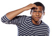 unsure dark-skinned young man with glasses try to focus