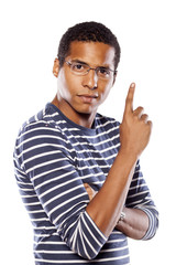 serious dark-skinned young man with glasses shows a finger up