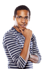 smiling dark-skinned young man with glasses and arms crossed