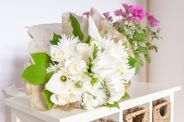wedding bouquet of mainly white flowers