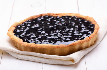 Blueberry pie on white wooden table