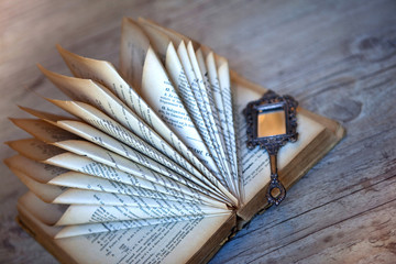 Decorating with an old folded book and a miniature mirror