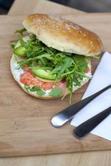 Hamburger with smoked salmon, avocado and green salad