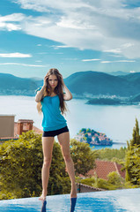 Beautiful girl model posing over a seaside luxury resort in Mont