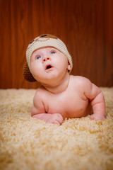 Beautiful baby girl in funny cap