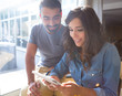 Couple using tablet with sunbeams and lens flare