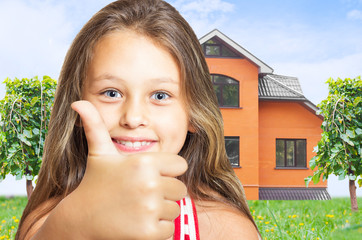girl with long hair shows thumb on red house