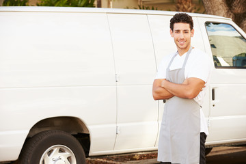 Man Wearing Apron Standing In Front Of Van