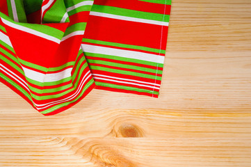 bright kitchen towel on wooden board