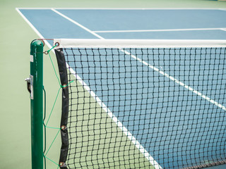 Tennis blue hard court with net before competition in sunny day