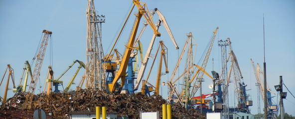 Panoramic view of harbour with scrap metal and cranes
