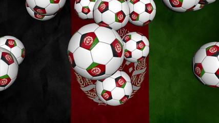 Afghanistan soccer balls falling on flag background