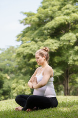 pregnant woman mother belly relaxing park yoga prayer
