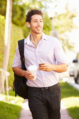 Man Walking Along Street To Work Listening To Music