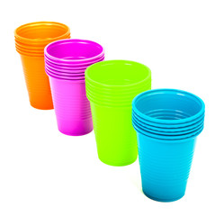 Bright plastic cups isolated on white