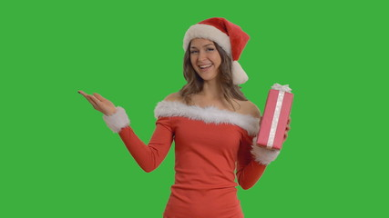 Young beautiful woman with gift shows copy space