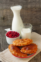 Breakfast with milk and cakes cranberries