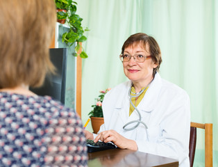 Female  doctor and patient talking
