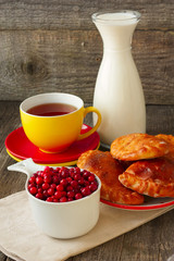 tea and cakes, cranberries and milk