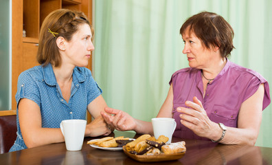 Mature woman talking with her young daughter
